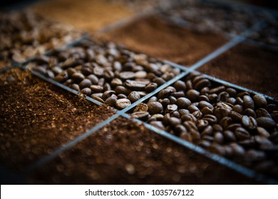Wooden box with three kinds of coffee beans and ground coffee