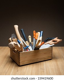 Wooden box with tools on the table