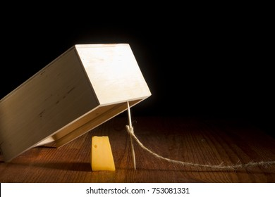 Wooden box as a trap on a black background