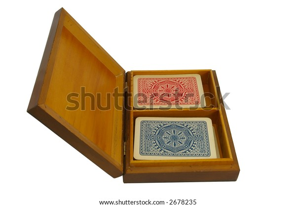 A wooden box with two packs of playing cards - left