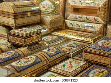 Wooden boxes with marquetry design in the form of Persian Khatam Inlay decorated with miniature paintings in Isfahan, Iran.