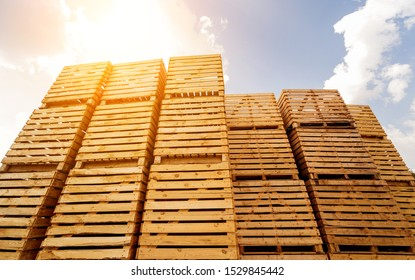 Wooden boxes stacked on each other. Outdoors. Blue sky background. Industrial