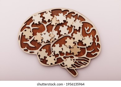 Wooden brain and puzzles. Mental Health and problems with memory