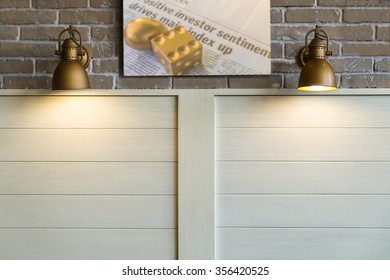 Wooden and Brick wall with wall lamps and one financial and investment concept photo.