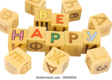 Wooden bricks with letters, â??be happyâ?� in English is surrounded by Russian characters, isolated