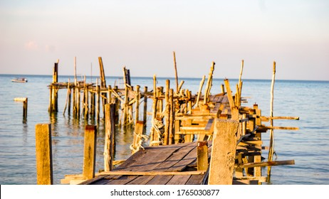 Wooden bridge along the sea at Monkey Beach penang,Malaysia tourists can come along and get boat ride towards monekey beach from here.