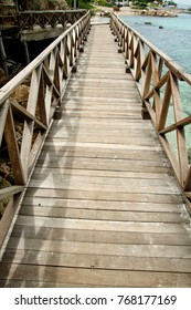 wooden bridge along the sea pier