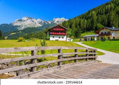 Wooden bridge to alpine village in summer, Austria