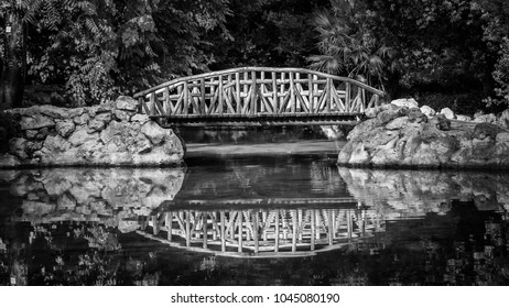 wooden bridge in the Athens National Garden , known as the Royal Garden , Greece