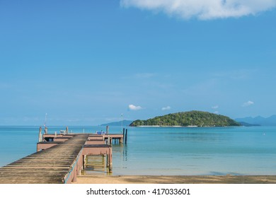 A wooden Bridge and clear blue sky and sea