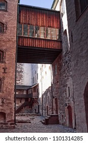A wooden bridge combines the tower to the main castle in the medieval castle of Turku in Finland.