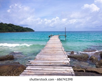 Wooden bridge connecting to the sea