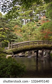 Wooden bridge covered in moss in traditional Japanese garden in Kyoto Imperial Palace, Japan