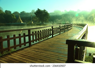 Wooden bridge cross the lake