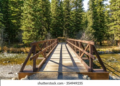 Wooden bridge crossing Hyalite Creek in Hyalite Canyon near Bozeman, Montana