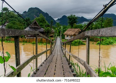 A wooden bridge crossing the Nam Song river Vang Vieng-Vientiane province-Laos.