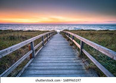 Wooden bridge leading to the beach, North Sea, Germany