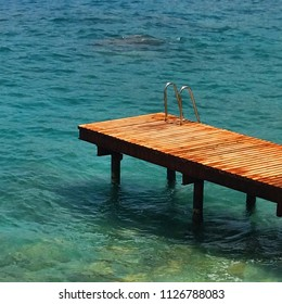 Wooden bridge leading to ladder at sea for swimming in Oludeniz, Turkey