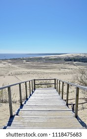 Wooden bridge leading to panoramic viewpoint of Nida dune in Lithuania. Seaside, sandy beach. The Parnidis dune over Nida and the Curonian lagoon. UNESCO World Heritage site