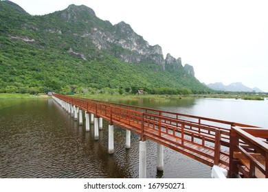 The wooden bridge in lotus lake and wood waterfront pavilion, at Khao Sam Roi Yot National Park in Thailand