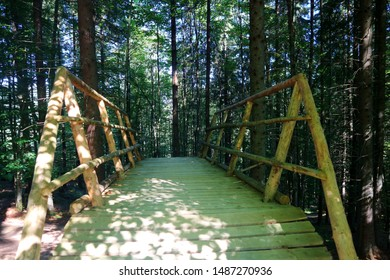 wooden bridge in the lusi forest of sunlight 			arch