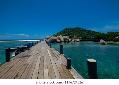 Wooden bridge in Nanyuan Island on a beautiful day, Thailand
