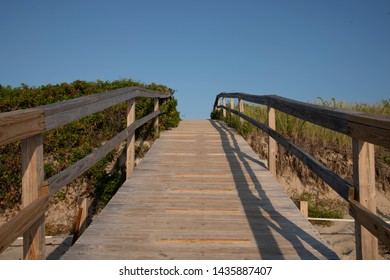 Wooden bridge in natural setting, sky with room for text