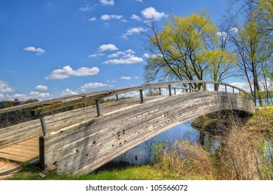 Wooden bridge at North Bay Park in Ypsilanti, Michigan. The bridge connected to a long and narrow trail on the lake.