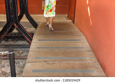 Wooden bridge at the old train station - woman crossing