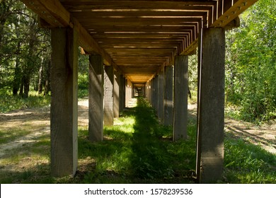 Wooden bridge on concrete poles underside in park