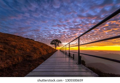 Wooden bridge on mountain with sunrise of DOI PUI CO mountain, beautiful view point of the famous in Mae Hong Son Province, Thailand.
