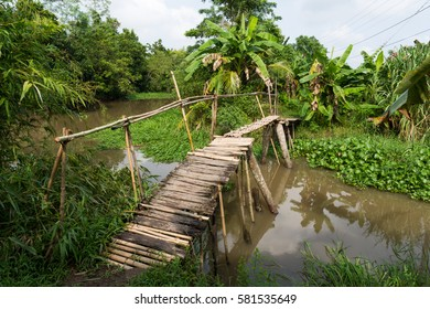 Wooden bridge over a canal of Can Tho, Vietnam. Can Tho is the biggest city in the Mekong delta.