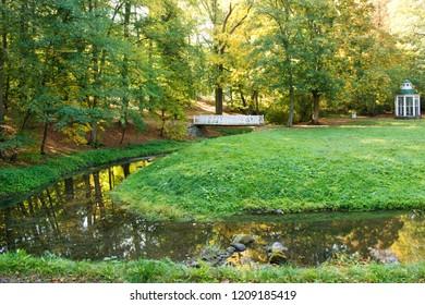 Wooden bridge over creek in the autumn park