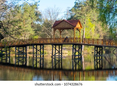 Wooden bridge over the lake in Pushcha-Voditsa, Kiev