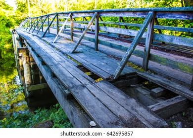 Wooden bridge over the lake in the village of Pushcha-Voditsa, Kiev region, Ukraine.