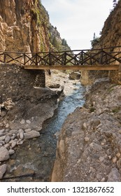 Wooden bridge over mountain river at rocky terrain of Samaria gorge, south west part of Crete island, Greece