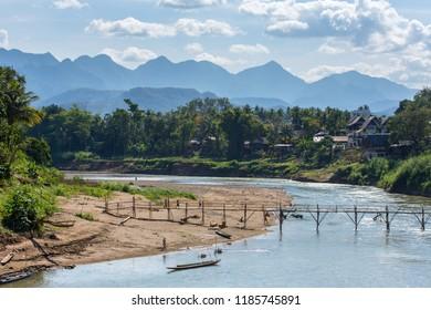 Wooden bridge over Nam khan rive in Luang Prabang, Laos