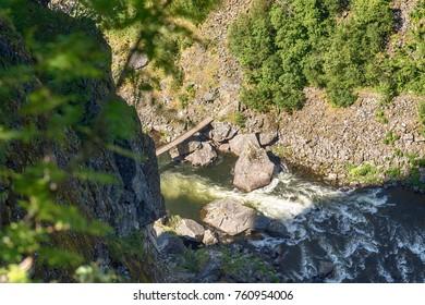 wooden bridge over a rapid river