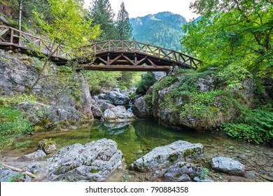 Wooden bridge over a river in the mountains of Olympus. Prionia, Greece
