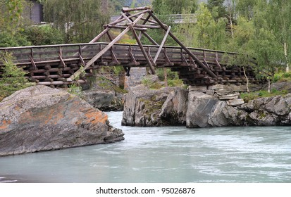 wooden bridge over the rocks and river