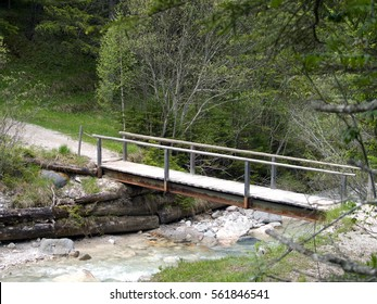 wooden bridge over a small water