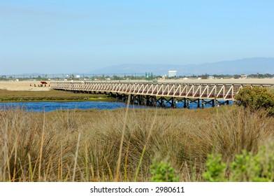 Wooden Bridge Over Tidal Inlet