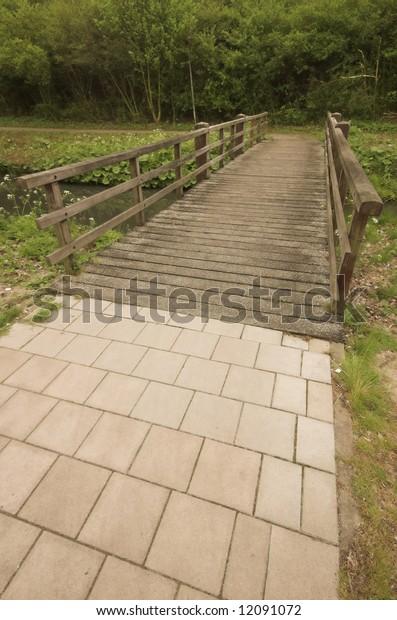 Wooden bridge for pedestrians over a canal