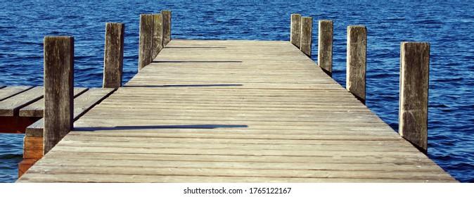 Wooden bridge pier on lakeside