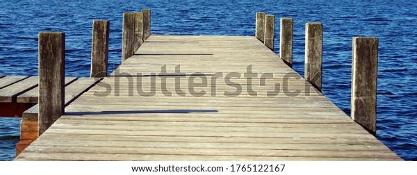 wooden-bridge-pier-on-lakeside-600w-1765