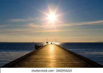 Wooden bridge to the sea at sunset beach in island Koh Samui, Thailand. Vacation and holiday concept