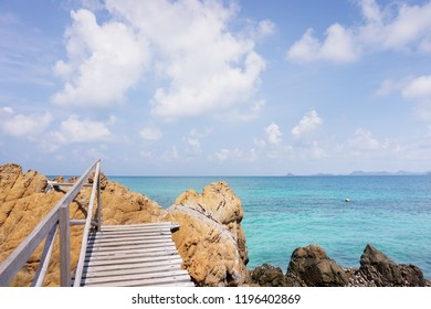 wooden bridge in  stone coast with beautiful sea and blue sky