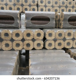 Wooden briquettes wrapped in foil, delivered to heat in winter