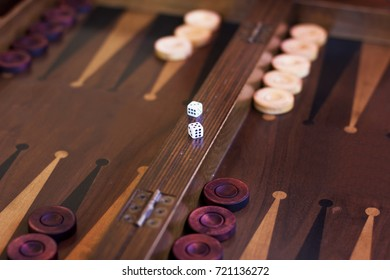 Wooden brown backgammon game with the dice