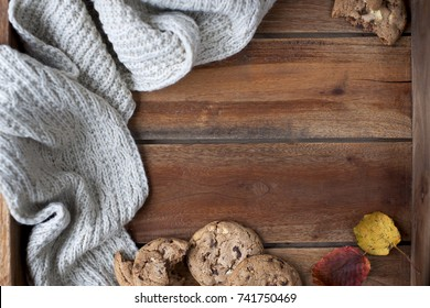 wooden brown background and gray woolen plaid with chocolate cookies